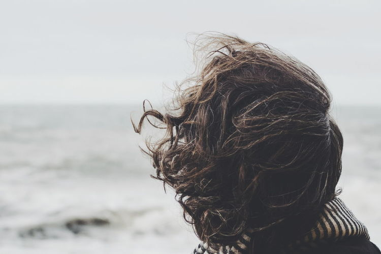 Portrait of man on beach against sky