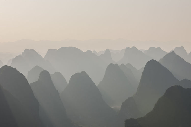 Silhouette mountains against sky during sunset