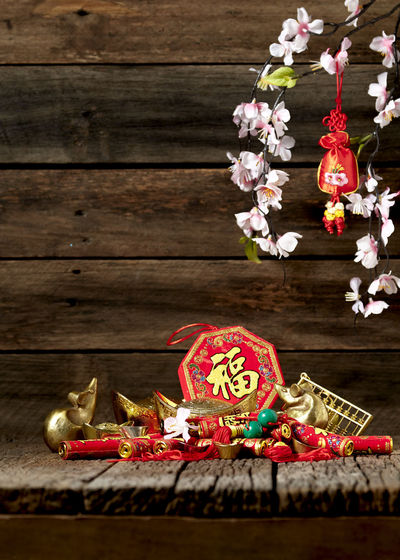Chinese New Year Lunar New Year Good Luck Decoration Festive Wooden Table Luck Mascot Flat Lay Celebration Craft Firecrackers Ornament Gold China 2020 2019 Pig Minimal Sales Envelope Celebrations Flowers Lucky Tradition Symbol Red Fu Background Festival Spring Holiday Traditional Gold Culture Oriental Fortune Asian  ASIA Packet Plum Blossom Design Celebrate Greeting Prosperity Auspicious Money Happiness Firecracker Ingot Wood - Material Flower Flowering Plant No People Art And Craft Plant Indoors  Nature Close-up Human Representation Representation Hanging Food And Drink Tree