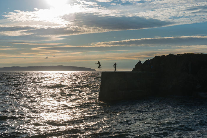 Guys having fun at the harbour. Adrenaline Junkie Atlantic Danger Diving Donegal Fun Harbour Jumping Into Sea Londonderry No Identifiable People Portstewart Risky Rough Sea Seascape Sunset