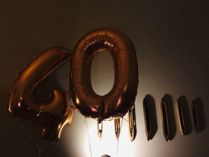 40 40th Birthday 40 Birthday Balloons Birthday No People Close-up Indoors  Communication Illuminated Text Nature Music Still Life Sign Metal Light Light - Natural Phenomenon Reflection Lighting Equipment