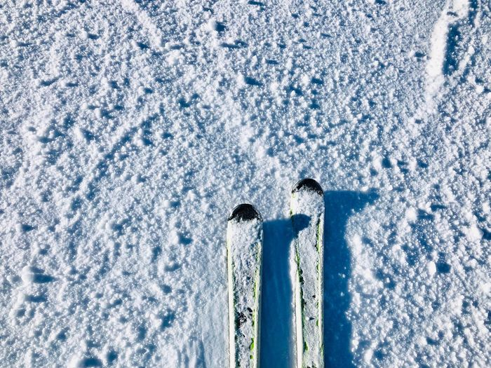 Skis on the snow - minimalism No People Skiing Resort Mountain Range Resort Mountain Slope Motion Action Activity Minimalistic Minimalism Minimal Equipment Winter Sport Sports Skis Skiing Cold Temperature Nature Day Winter No People Snow Frozen Outdoors Sunlight White Color High Angle View Environment Backgrounds