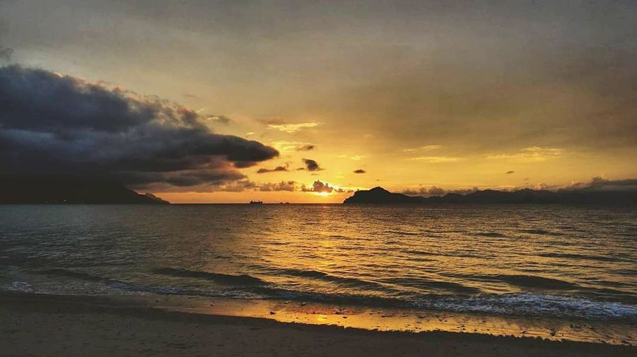EyeEmNewHere EyeEm Selects Langkawi Multi Colored Sea Sunset Beach Sun Dramatic Sky Horizon Over Water Vacations Travel Destinations Silhouette Sky Cloud - Sky Nature Sand Reflection Water Outdoors Landscape Summer Social Issues No People