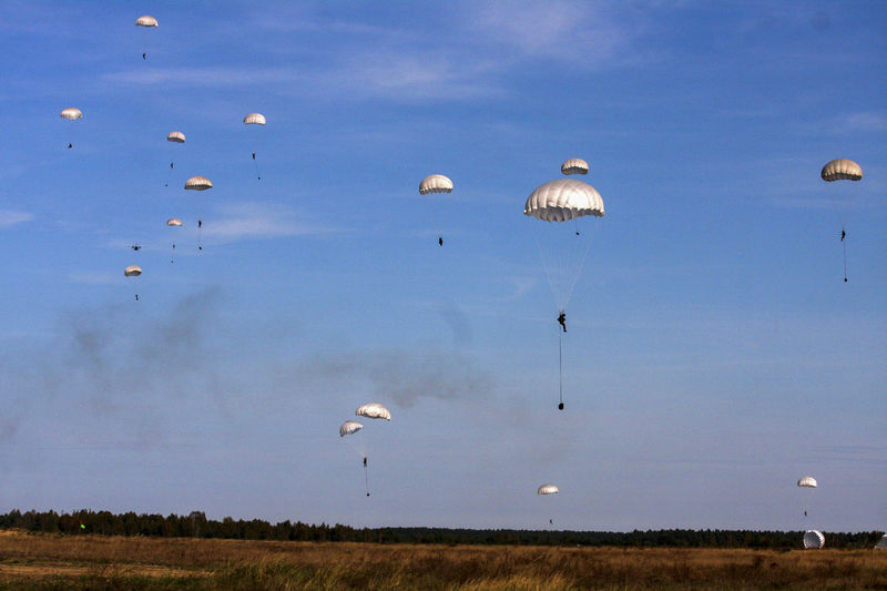 Low angle view of parachutes against sky