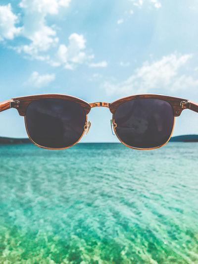 Sunglasses against sea