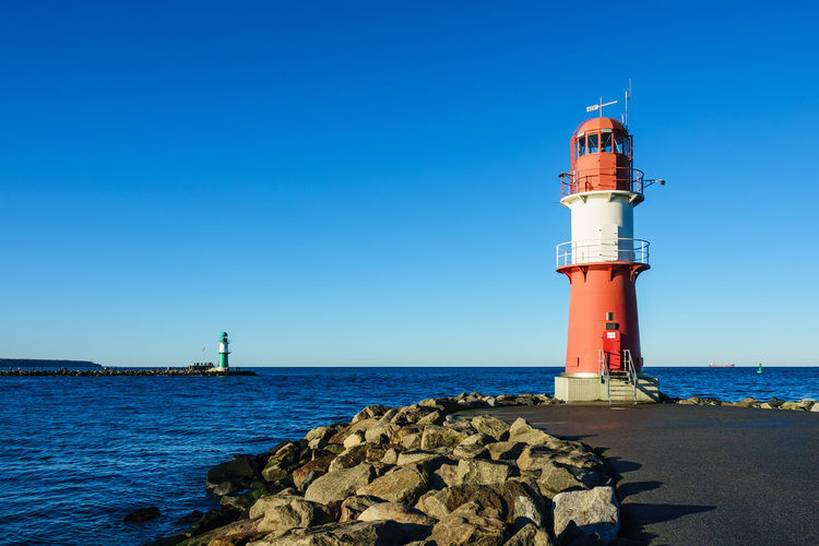 Mole in Warnemuende, Germany. Baltic Sea Lighthouse Relaxing Rostock Warnemünde Blue Clear Sky Coast Day Guidance Landmark Lighthouse Mole Nature No People Outdoors Sea Shore Sky Stones Tourism Travel Destinations Vacation Warnemuende Water
