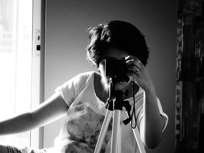 Woman Photographing Through Camera At Home