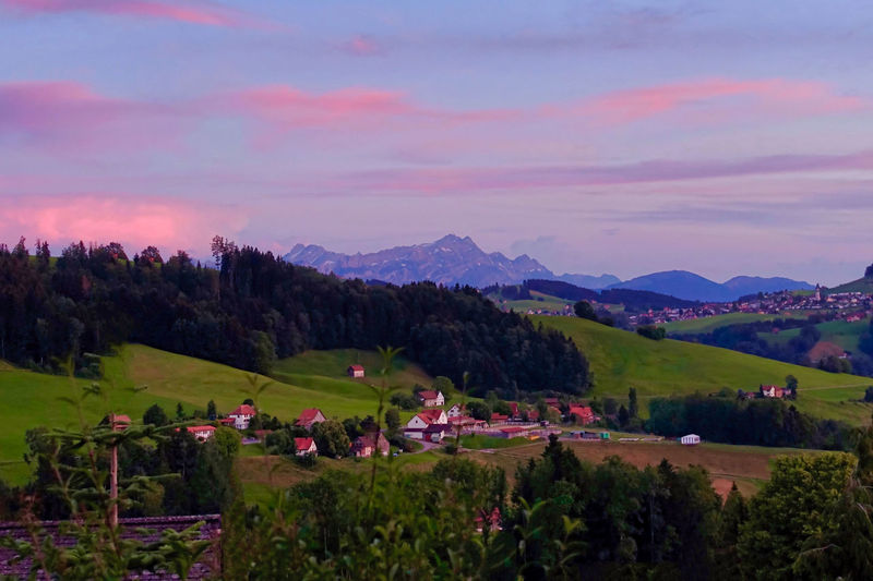 The county of Appenzell and Mount Säntis at sunset. Architecture Beauty In Nature Built Structure Cloud - Sky Environment Field Growth Land Landscape Mountain Mountain Range Nature No People Non-urban Scene Outdoors Plant Scenics - Nature Sky Sunset Tranquil Scene Tranquility Tree