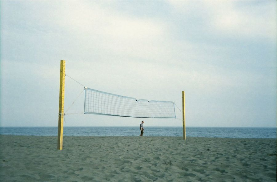 Beach Volleyball Beach Beach Volleyball Beauty In Nature Day Goal Post Horizon Over Water Leisure Activity Lifestyles Men Nature Net - Sports Equipment One Person Outdoors People Playing Real People Sand Sea Sky Sport The Great Outdoors - 2017 EyeEm Awards Volleyball - Sport Water