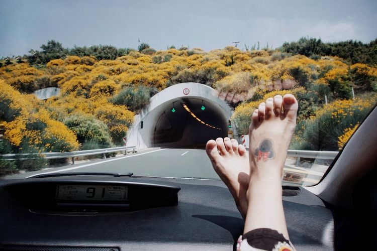 Road Road Trip Car Car Ride  Nature Tunnel Travel Traveling Travelling Yellow Flowers Low Section Human Leg barefoot Human Foot Mid Adult Limb Sky Foot Toe Leg Windshield Dashboard Car Interior Car Point Of View Feet Up Moving Feet Inner Power Summer Exploratorium Visual Creativity This Is My Skin #FREIHEITBERLIN The Great Outdoors - 2018 EyeEm Awards The Traveler - 2018 EyeEm Awards The Still Life Photographer - 2018 EyeEm Awards 10 A New Beginning This Is Natural Beauty A New Perspective On Life Moments Of Happiness