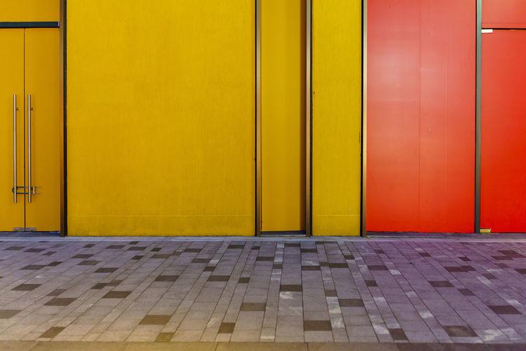 Closed door of yellow building