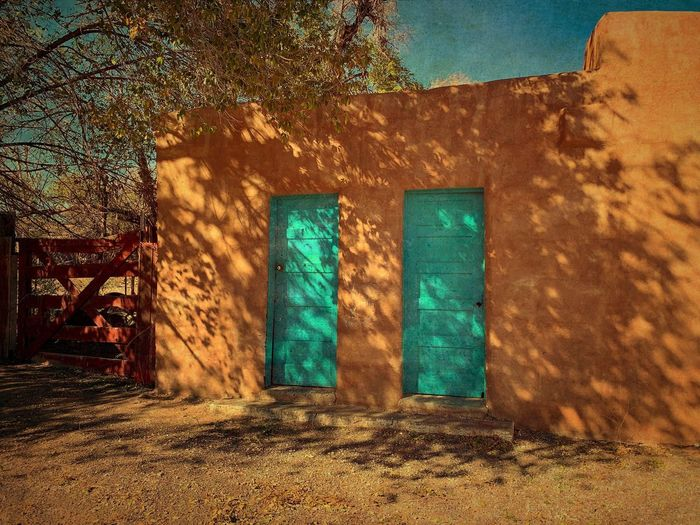 """""""Two Doors In San Fidel"""" Two bright, turquoise doors, a classic Southwest color, brighten up an old historic building on Route 66 in the tiny Village of San Fidel, New Mexico. New Mexico New Mexico Photography Adobe Building Adobe Route 66 Historic Building Doors Torquoise Built Structure Building Exterior Architecture Building No People"""