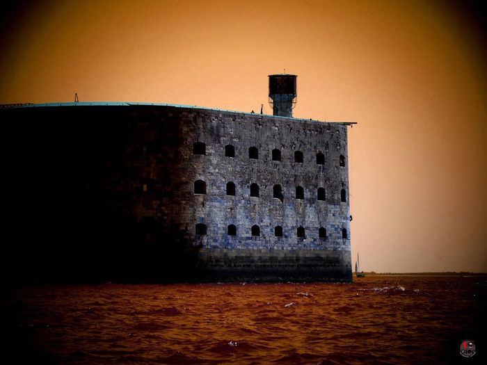"""Fort Boyard is a fort located between the Île-d'Aix and the Île d'Oléron in the Pertuis d'Antioche straits, on the west coast of France and is the filming location for the TV gameshow of the same name. Though a fort on Boyard bank was suggested as early as the 17th century, it was not until the 1800s under Napoleon Bonaparte that work began. Building started in 1801 and was completed in 1857. In 1967, the final scene of the French film Les aventuriers was filmed at the remains of the fort."" Fort Boyard France 500px 10dier Graphic Design Source: Wikipedia"
