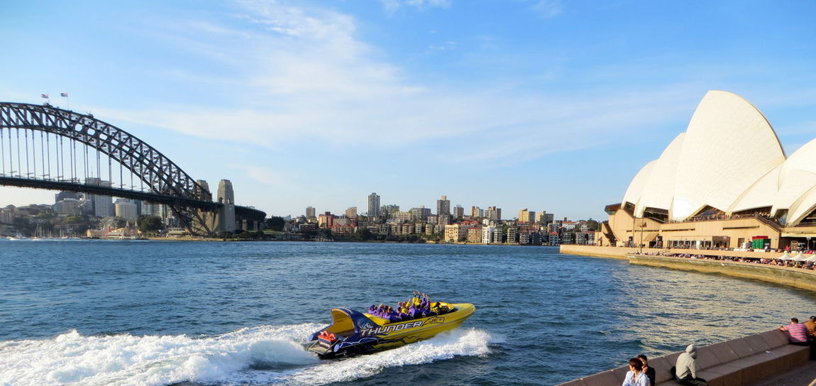 Architecture Blue Boat Built Structure City Day Excitement Jet Boating! Motion Nautical Vessel Outdoors Passenger Craft Sea Sky Sydney Harbour  Sydney Harbour Bridge Sydney Opera House Tourism Transportation Travel Destinations Vacations Wake Wake - Water Water Waterfront