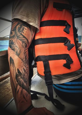 Human Arm Indoors  One Person Human Body Part Low Section Close-up Day People Tattoo Life Vest Philippines El Nido, Palawan Boat El Nido, Palawan Philippines Snorkeling Young Adult Vacations Leisure Activity Shotoniphone7