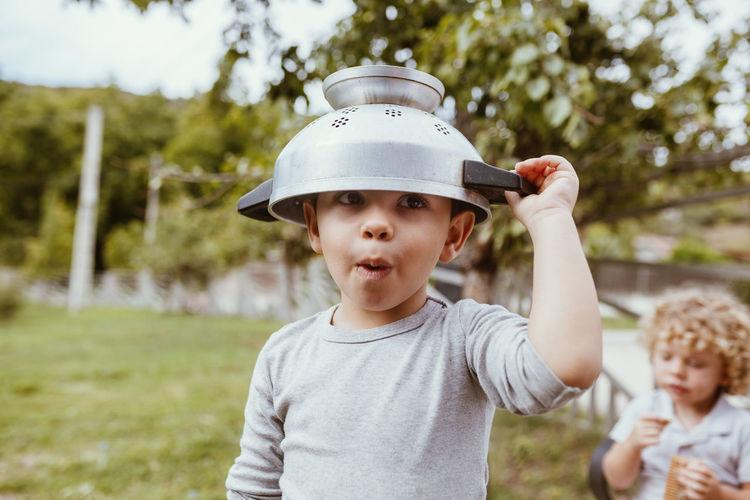Portrait of cute boy in park