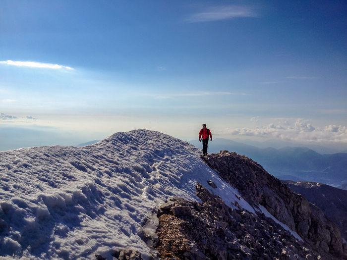 Man hiking on snowcapped mountain at triglav national park