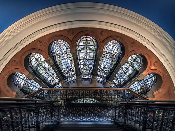 Arch above Stained Glass Windows Arch Architecture Architecture And Art Building Built Structure Ceiling Day Design Directly Below Glass Glass - Material Indoors  Low Angle View No People Ornate Pattern Place Of Worship Religion Skylight Spirituality Stained Glass Window