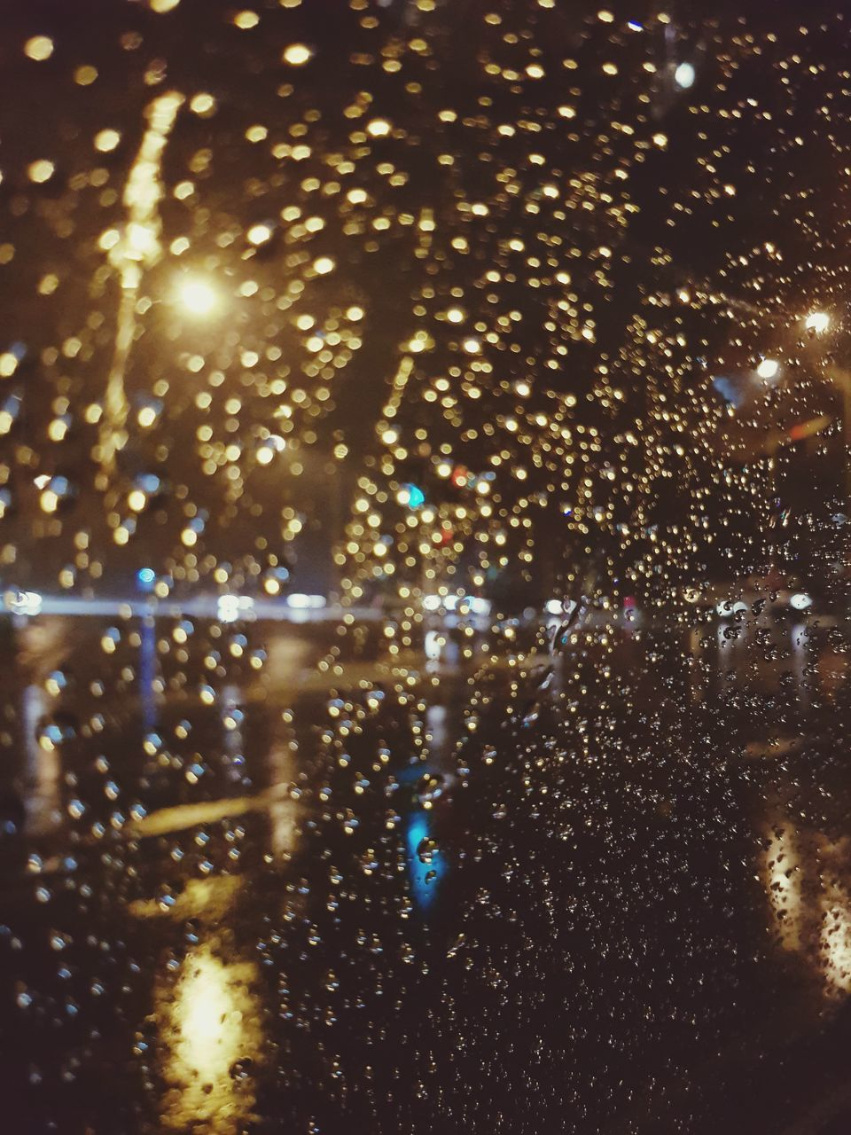 illuminated, night, drop, no people, wet, water, window, raindrop, close-up, indoors, backgrounds, defocused, nature, sky