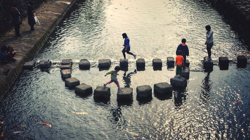 On The Bridge Water Reflections Ordinarypeople Nakashima River Nagasaki City / LUMIX G VARIO 50mm Spot Urban3 filter plus People Watching 16:9 Crop Waltz for Childrens http://youtu.be/dH3GSrCmzC8 水の音楽 II The Moment - 2015 EyeEm Awards