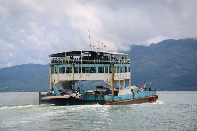 Thai Ferry Ferry Ferryboat Island Leaving Leaving Behind Mountain Nautical Theme Nautical Vessel Nautical Vessels Outdoors Rotten Sky Thailand Transportation Transportation Vehicle Water Water_collection