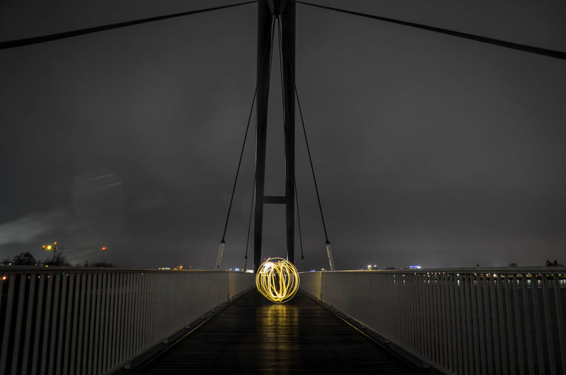 Light painting in the most beautiful city Gold Modern Orb Architecture Bridge - Man Made Structure Built Structure City Connection Contrast Illuminated Lightpainting Night No People Outdoors Railing River Sky Street Light Suspension Bridge Transportation Travel Destinations Water Stories From The City EyeEmNewHere The Architect - 2018 EyeEm Awards