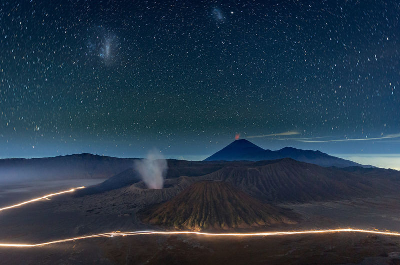Volcanic mountains against sky at night