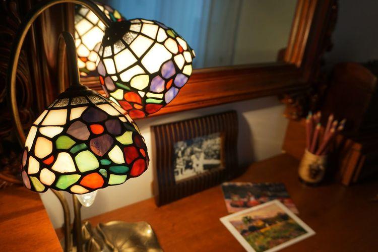 Close-up of illuminated lamp shade at home