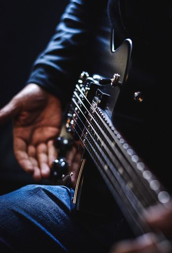 Guitarplayer Guitar One Person Human Body Part Musical Instrument Arts Culture And Entertainment Music Hand Musical Equipment Human Hand Musician Body Part Human Leg Real People Indoors  Adult Artist Midsection Men Playing Jeans Close-up