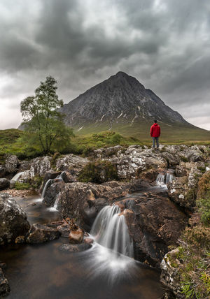 Scottish Highlands Scotland Scenics - Nature Mountain Nature Sky Water Tranquil Scene Land Outdoors Flowing Water Waterfall Rock Hills Cloud - Sky Beauty In Nature Environment Hiking Adventure Weather Day Power In Nature One Person Mountain Range