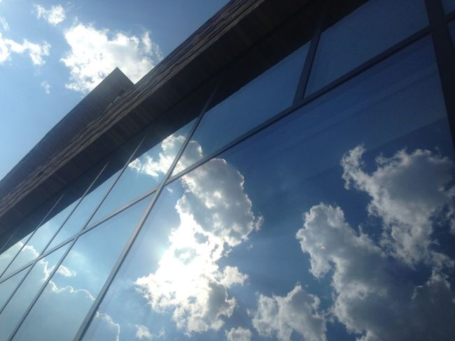 Reflection On Building Clouds And Sky Nhow Berlin