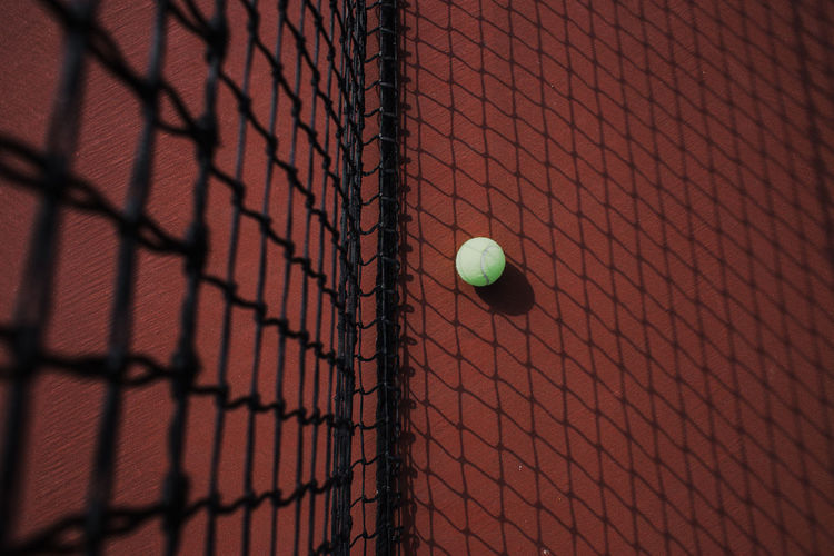 Green tennis ball on the ground