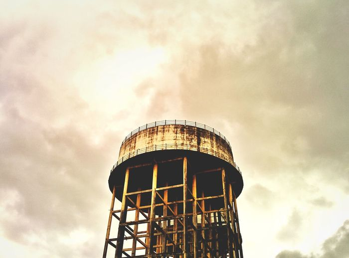 Low angle view of water tower against sky