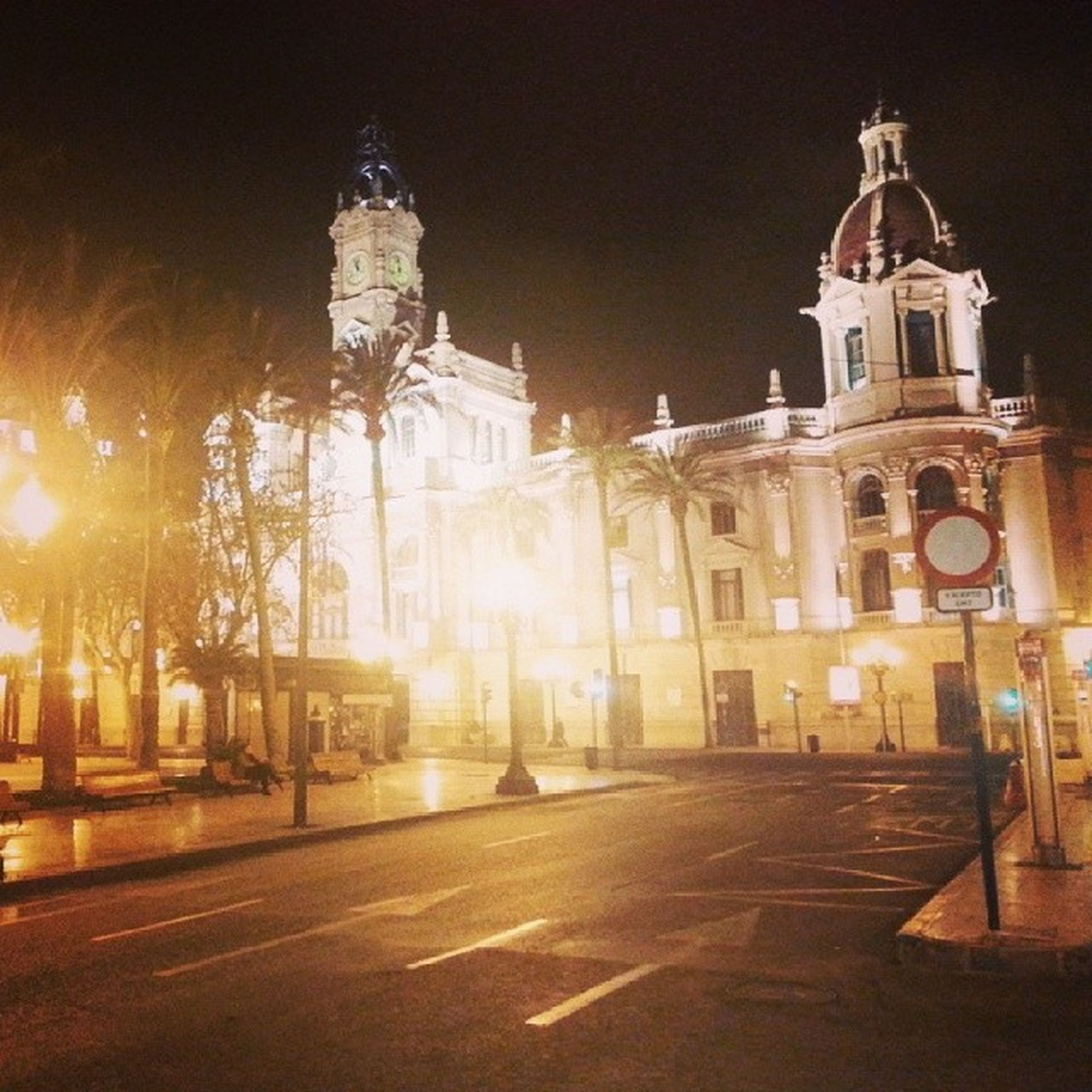 building exterior, night, illuminated, architecture, built structure, religion, place of worship, church, spirituality, street light, cathedral, street, lighting equipment, sky, city, outdoors, road, cross