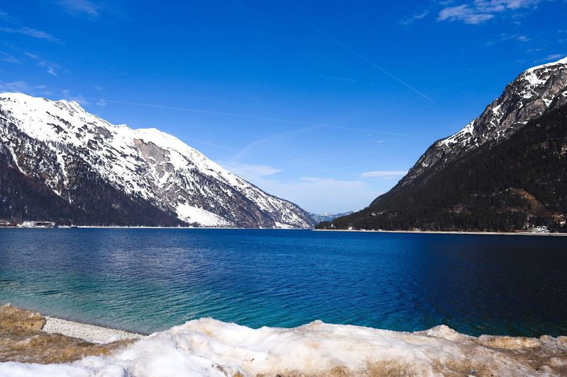 Achensee im schönen Tirol Water Scenics - Nature Mountain Blue Sky Beauty In Nature Tranquil Scene Lake Nature Day Mountain Range Idyllic Non-urban Scene No People Reflection Snow Outdoors Snowcapped Mountain Tranquility The Great Outdoors - 2019 EyeEm Awards