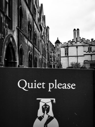 Let's begin the next series, Books and Stones. Explore Oxford with me. Books And Stones Sign Be Quiet Old Blackandwhite Bnw_collection Black White University City Text Sky Building Exterior Directional Sign Information Information Sign Signboard