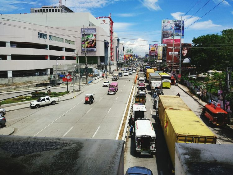 The usual traffic along the busiest highway within the city of Cagayan de Oro. Claro M. Recto highwayi on a sunny day. The SM Downtown Premier on the left which was just days afyer its exciting opening last May 12, 2017. CDO Highways AH26 HighwayNumber9 Photographyonthego