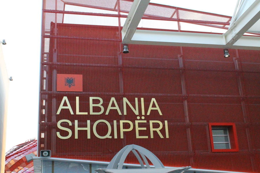 Albania Architecture Built Structure Close-up Communication Day Flag Low Angle View No People Outdoors Red Road Sign Shqiperia Text
