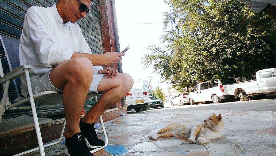 Me and tigrou One Animal Domestic Animals Pets Mammal Street Pet Owner Clear Sky Side View Men Sitting Lifestyles Full Length Person Cat Togetherness Day Relaxation Pampered Pets Feline First Eyeem Photo Nikehuarache✔👑