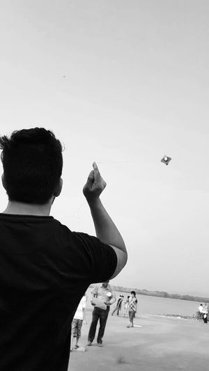 One Person Flying Airplane One Man Only Sky Adults Only Adult Only Men People Air Vehicle Human Hand Human Body Part Day Outdoors Scenics Tranquil Scene Monochrome Photography EyeEm Best Shots Cityscape Live Your Dream .. Share Your Passion .. Photography Lifestyles The Color Of School
