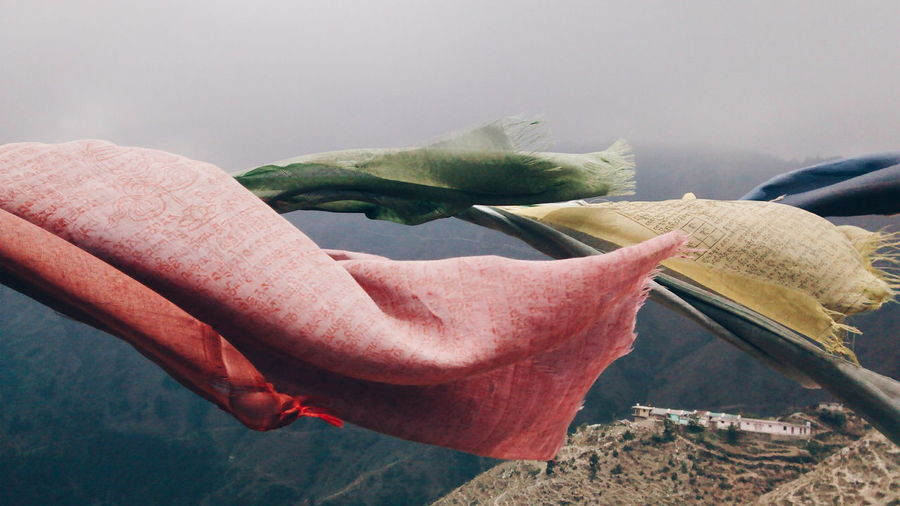 Prayer Flags Waving Above Mountains