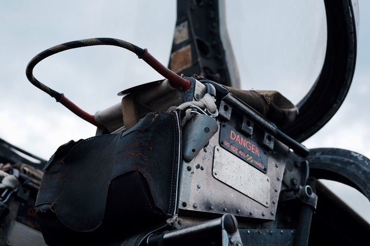 Close-up of machinery on motorcycle against sky