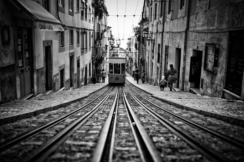 Cable Car On Street Amidst Buildings In City