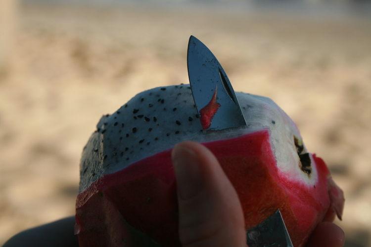 Cropped Hand Peeling Dragonfruit