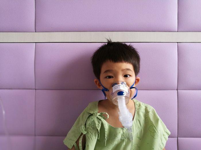 Portrait Of Boy Wearing Oxygen Mask At Hospital