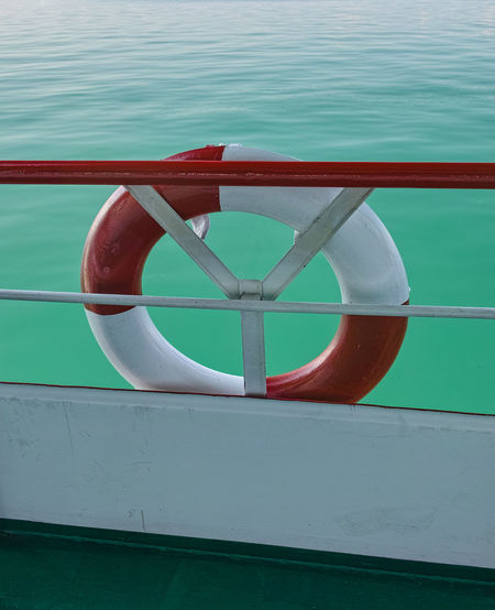 lifebelt Green Color Travel Boat Deck Circle Day Life Belt Lifebelt Lifebelt Sea Mode Of Transportation Nature Nautical Vessel No People Outdoors Protection Railing Red Rope Safety Sea Security Shape Transportation Travel Destinations Turquoise Colored Water
