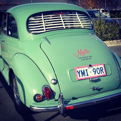 Vintage Morris Minor 1000 seen at a parking lot.