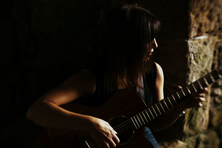 Mature woman playing guitar