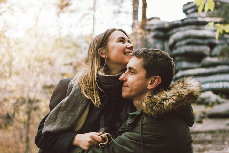 Smiling couple embracing outdoors