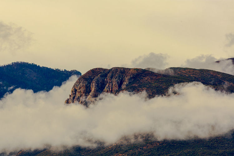 Clouds hover under the huachuca mountains